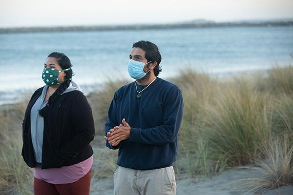 Couple in face coverings at Doran Beach