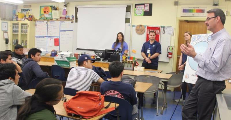 Bob Devine and other Tesoro employees speak to ITEP students at Carson High School during first Women in Engineering Day.