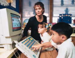 Small children using an intelikeys with a computer from the early 90s
