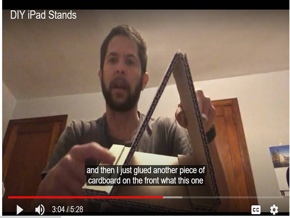 Image of the video link to Scout's video on how to make an iPad stand from several different recycled materials.