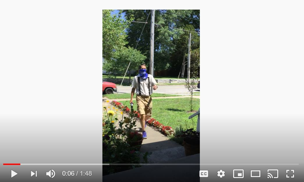 Video of Scout walking carrying an ipad by a foam handle.