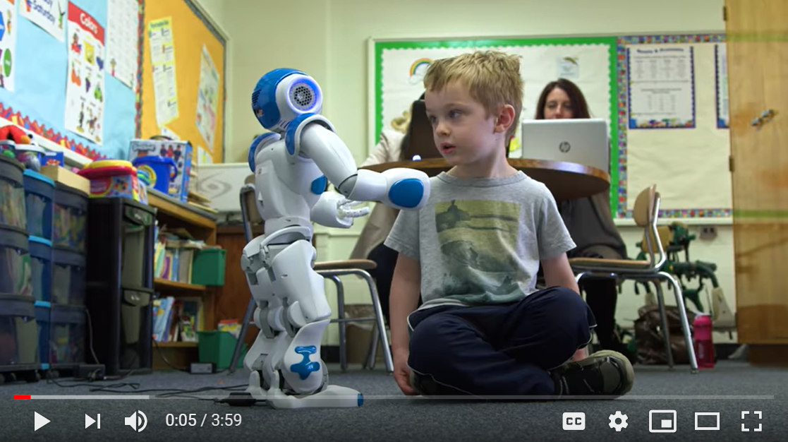Image of a young student with the NAO Robot