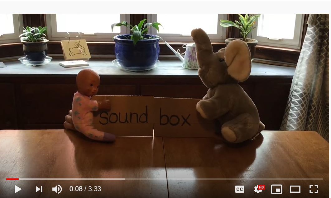 Sound Box video begins with two plush toys carrying the words sound and box approaching each other while sliding on the table
