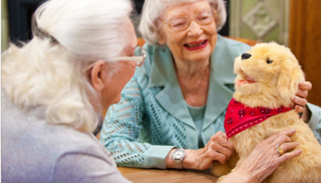 Joy for All Robotic dog with two older women
