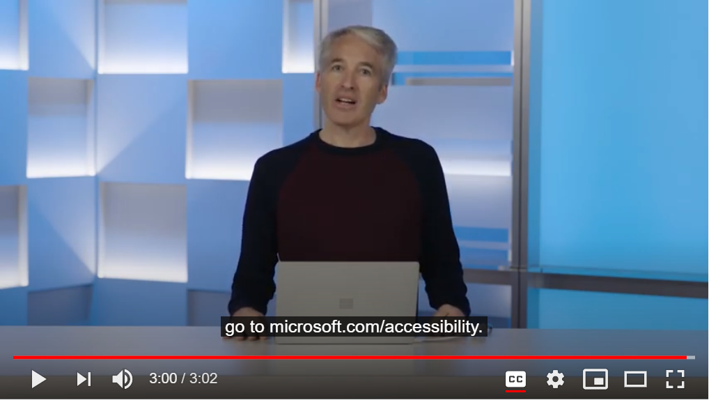 Employee from Microsoft positioned behind a laptop computer.  Link to video attached.