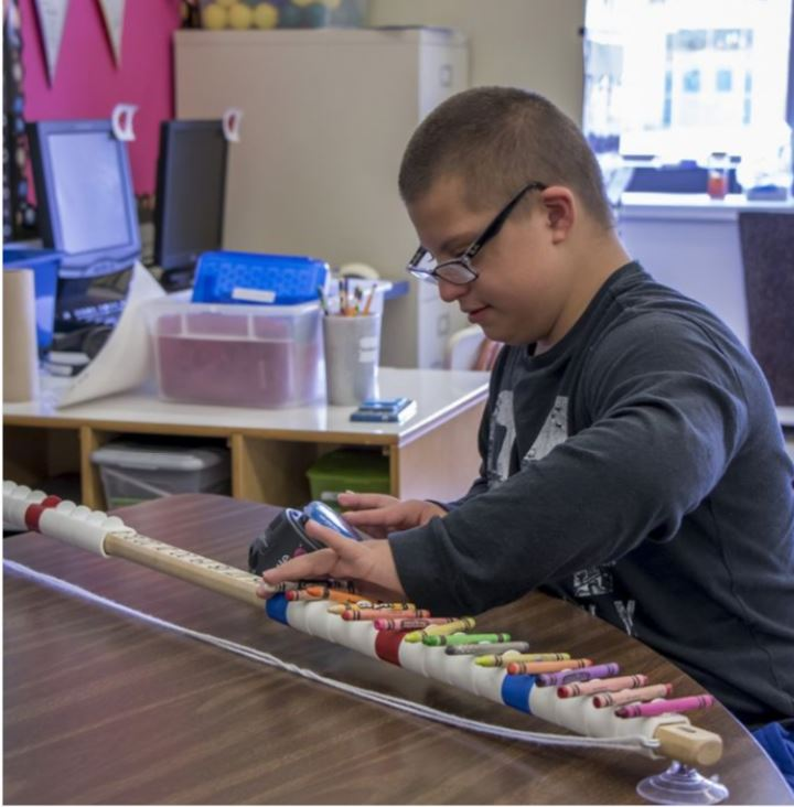 Image of student using the Equals Math manipulatives