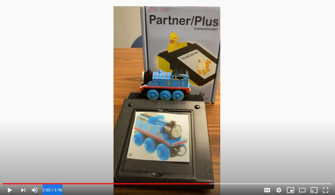 Image of a Thmoas the Tank engine on top of an AAC device