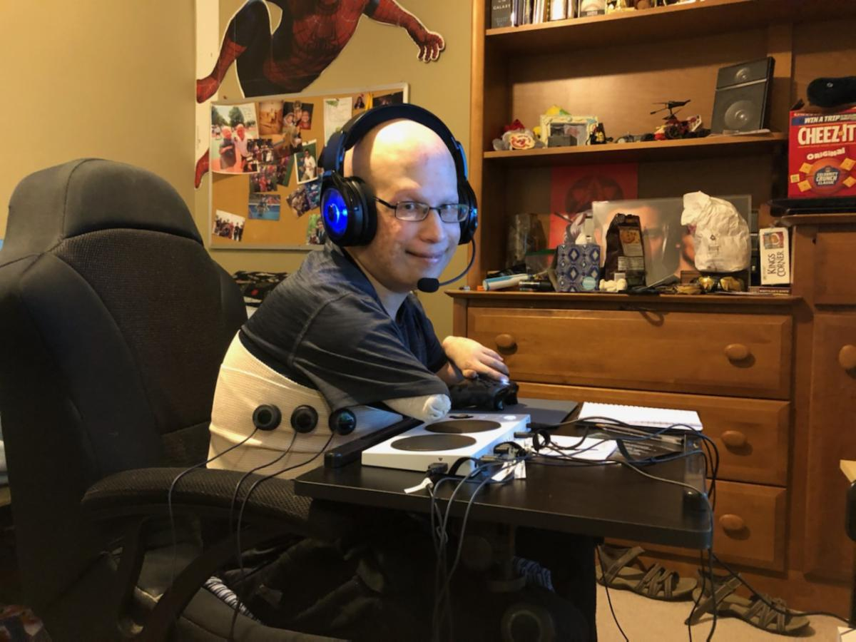 Brenden pictured using the adaptive gaming equipment loaned through Missouri Assistive Technology
