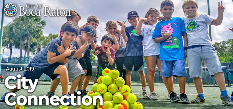 City of Boca Raton August 2019 City Connection. Group of kids on tennis court posing for picture.