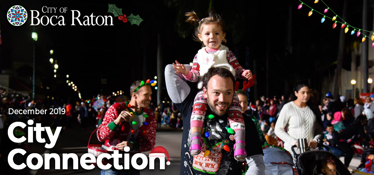 City of Boca Raton December 2019 City Connection. Girl on her dad's shoulders at the holiday street parade.