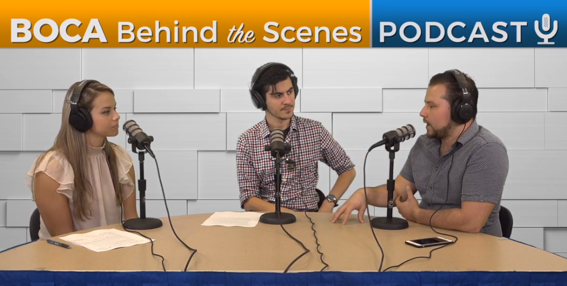 Three people at a desk with microphones recording Boca Behind the Scenes podcast