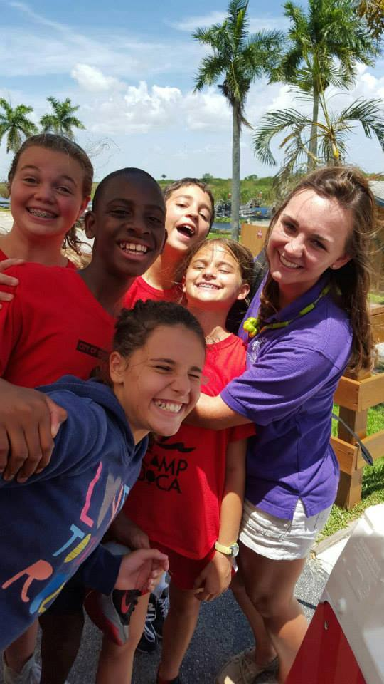 camp boca campers smiling with their counselor in the everglades