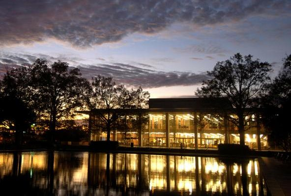 The sun sets over the Thomas Cooper Library on a chilly winter day.