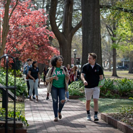 Students stroll along the brick walkways of the historic Horseshoe.