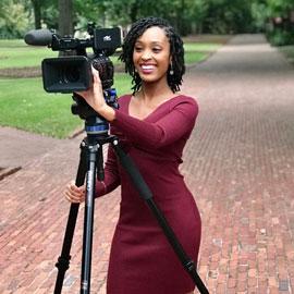 New graduate Dara Khaalid pursues her career as a broadcast journalist.