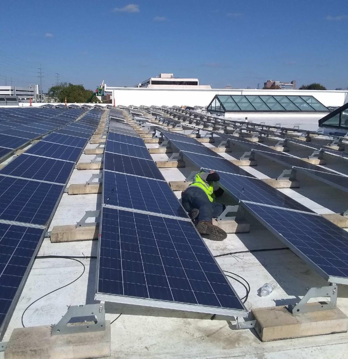 LightWave Solar technician installing solar panels at HCA in Nashville.