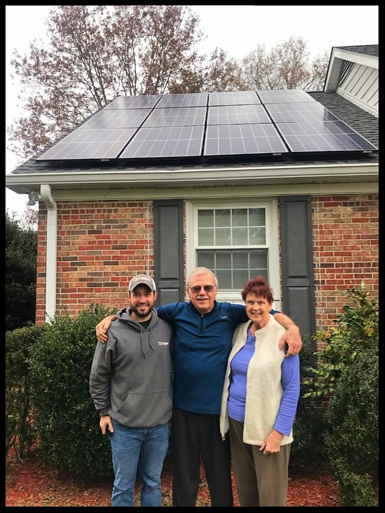 Residential solar system owners with LightWave Solar installer