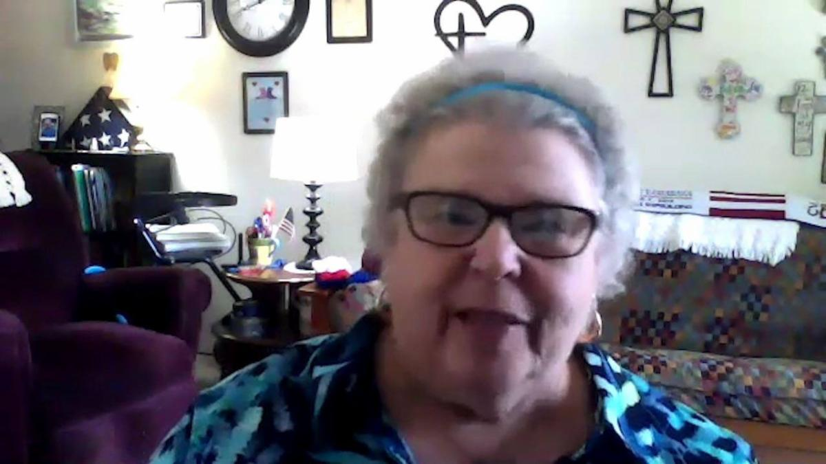 Photo of a woman speaking into her webcam