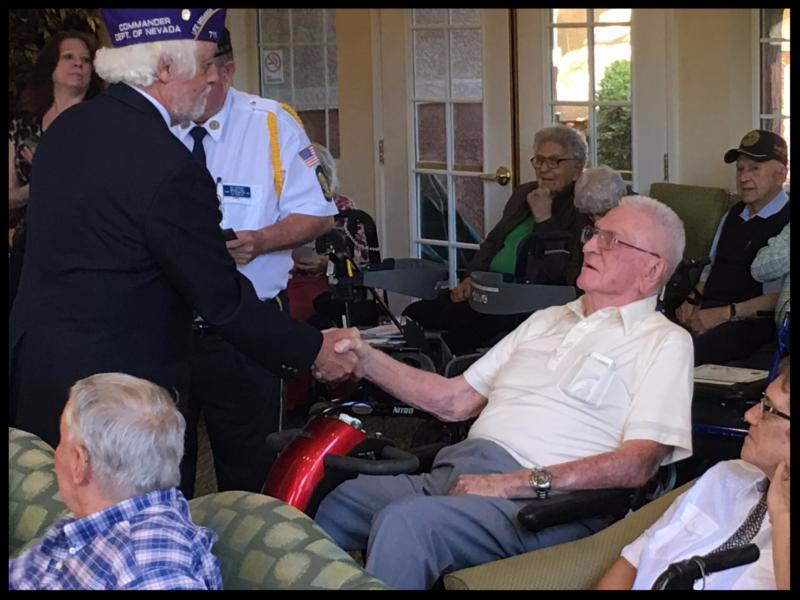 Commander Richard Small of the Military Order of the Purple Heart honors a veteran resident during one of NDVS' VIC (Veterans In Care) Ceremonies