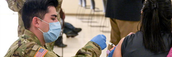 An Ohio National Guard administers a vaccine to an Ohioan