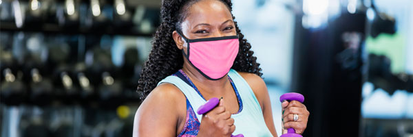 woman at the gym wearing face mask