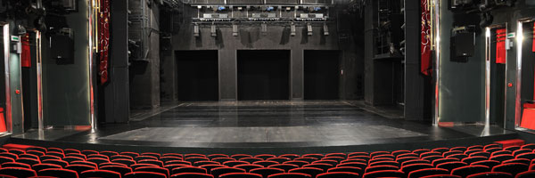 the stage and seats of an empty theater