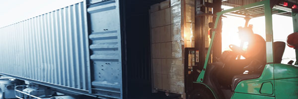 a forklift operator unloads a shipping container