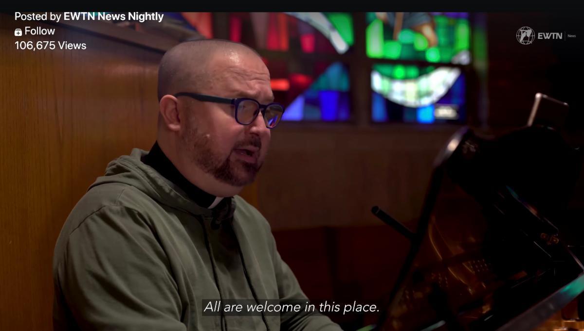 Fr Jim Worth playing piano while singing