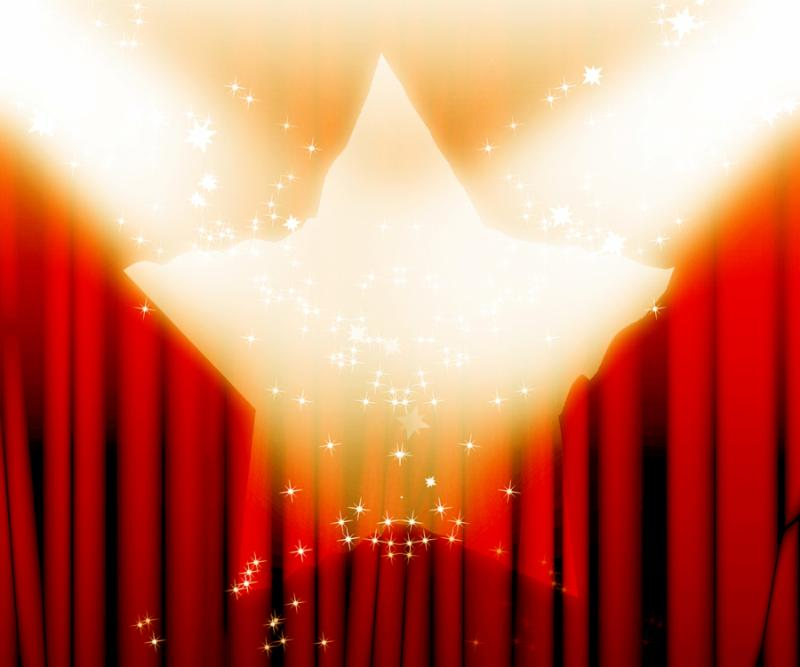 red movie or theater curtains with a bright spotlight on it