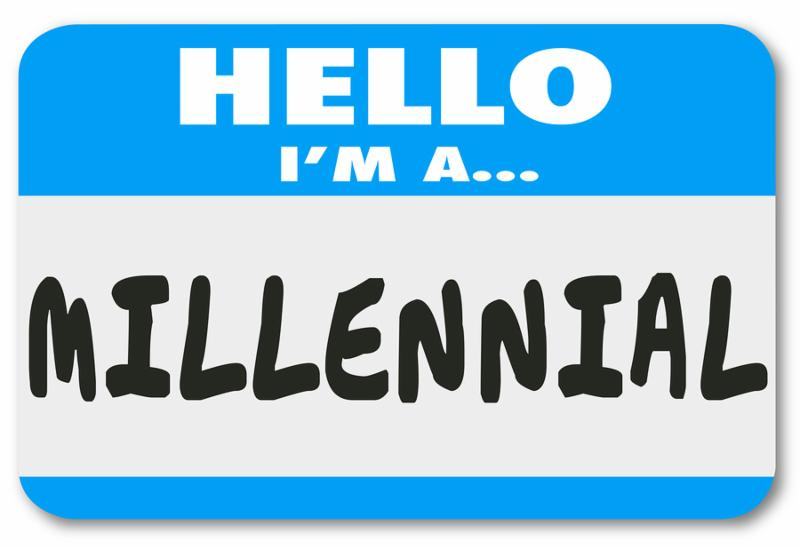 Hello I m a Millennial words on a nametag or sticker to illustrate a young person in the demographic group interested in mobile technology, texting and social networking