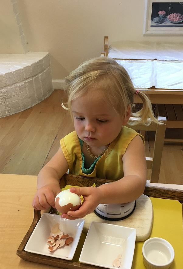 Rosie peels an egg