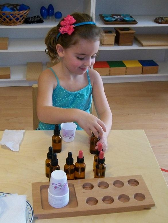 Child working with smelling bottles