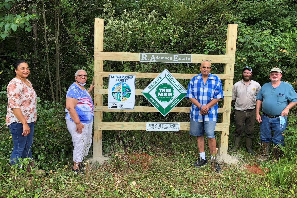 Program and Adamson Estate representatives participate in a sign installation ceremony that recognized their family land in Howard County, Arkansas, as a certified American Tree Farm.