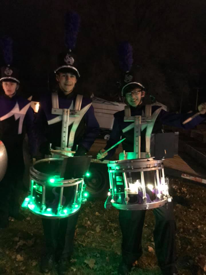 High School band members getting ready for Holiday Parade.