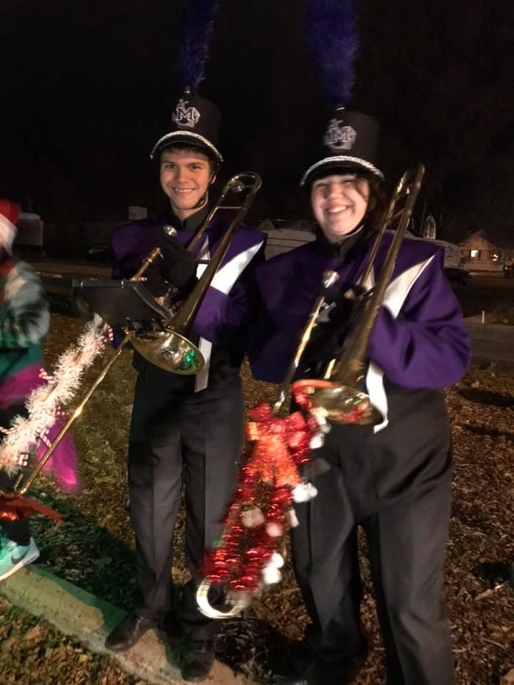 Band members performing for the Holiday Parade