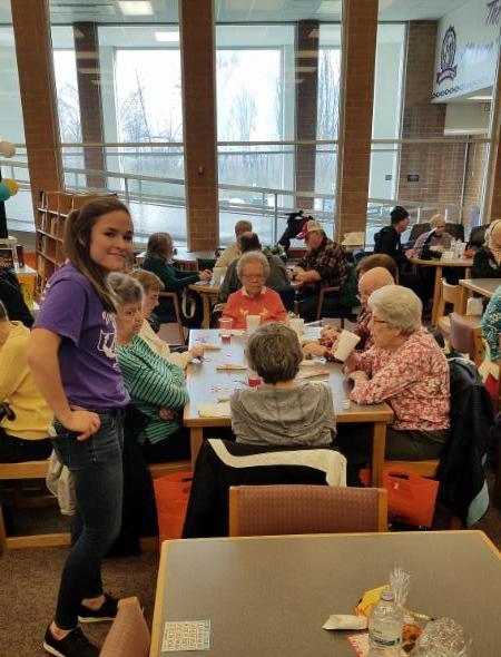Student Senate students serving treats at Senior Citizen's Day