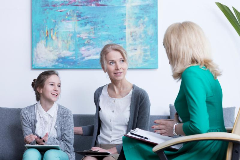 Mom and daughter with mental health professional