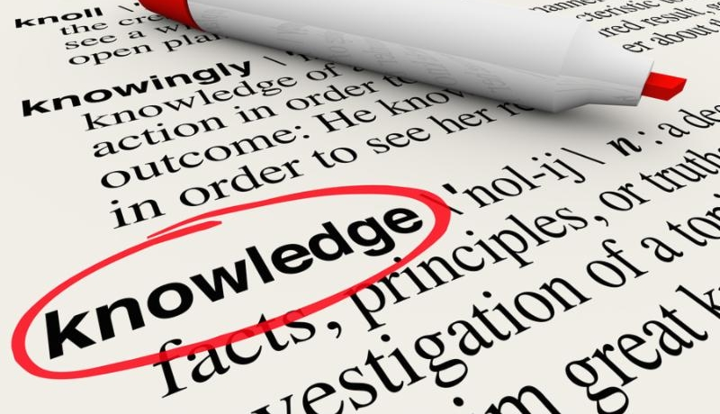 The word Knowledge circled in a dicitonary with its definition of great intelligence and...
