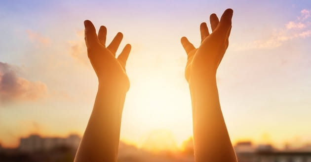 Hands lifted in prayer