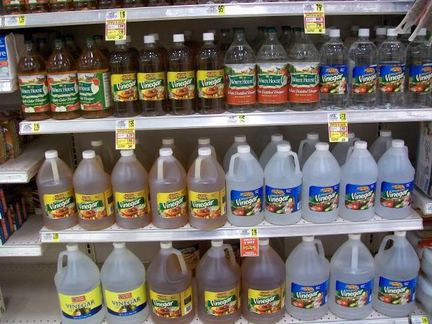 various types of vinegar on grocery store shelf