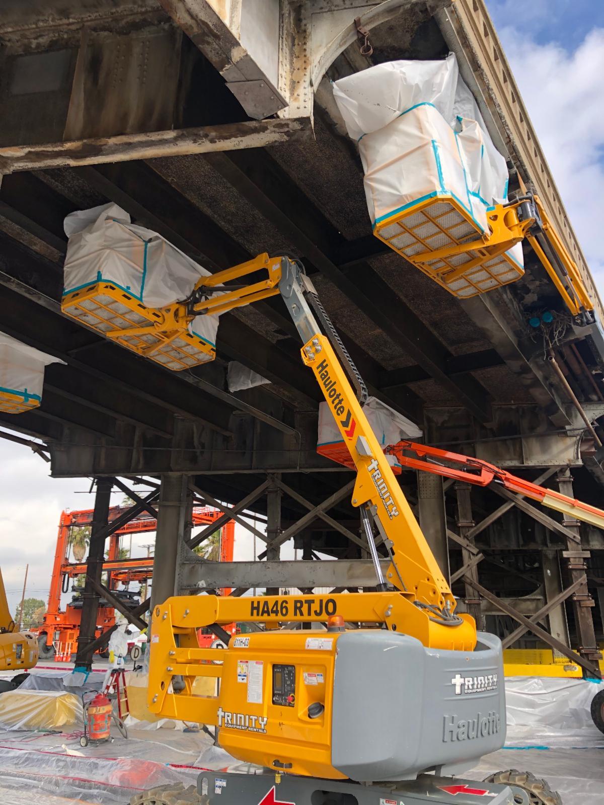 Removing bridge material below bridge deck