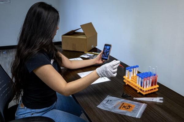 BridgeYear's Evelyn Melgar uses the organization's new health care industry career exploration kit (Photo credit: BridgeYear)