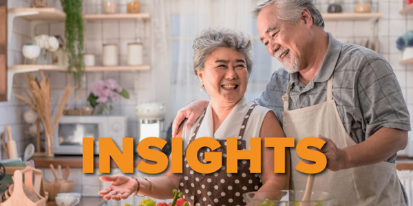 Insights graphic - happy older couple cooking in kitchen