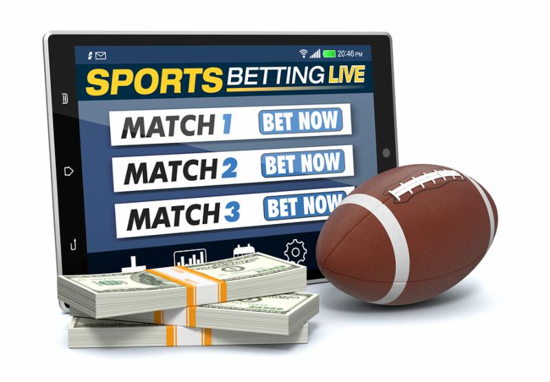 tablet pc with app for sport bets stacks of banknotes and a football ball concept of online bets  3d render