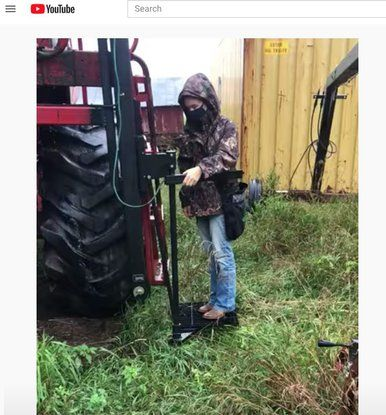 Picture of Abbie trying out the AgLift in the rain.