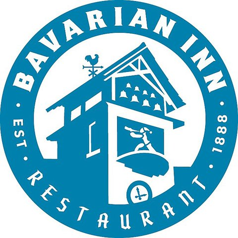 Round blue and white logo of the Bavarian Inn and Restaurant established in 1888 showing a drawing of the Inn's clock and bell tower.