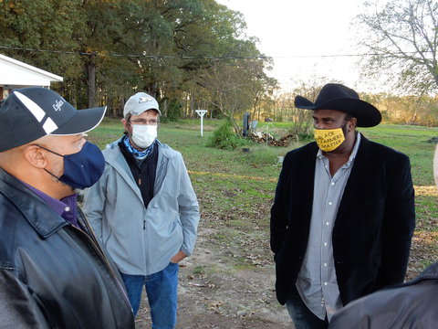 John Jamerson - Ed Sheldon and Dr. John Boyd wearing facemasks and talking outside on the Boyd farm.