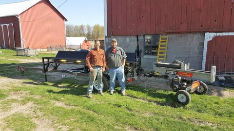 Ned Stoller and farmer standing outside of barn