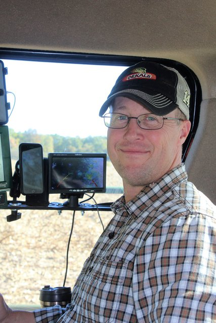 Picture of Jed Welder from the waist up sitting in a tractor cab.