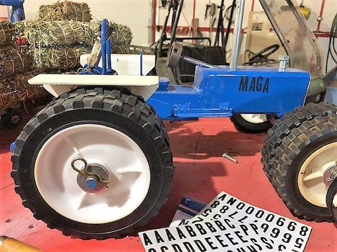Picture of blue toy tractor with white fenders